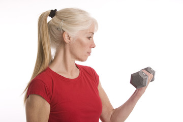 Middle-aged woman working out with bellbar
