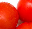 juicy fresh tomatoes. Vegetables are covered by drops of water.