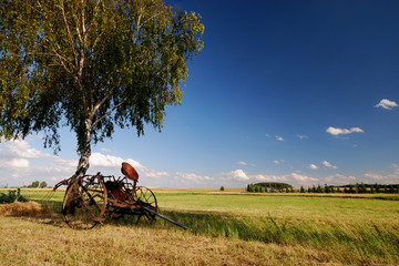 On countryside, old agricultural machine