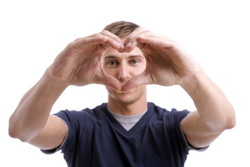 Young Man Drawing Heart with Hands - focus on hands