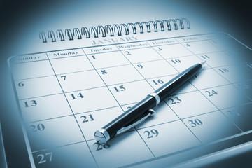 Close Up of Ballpoint Pen on Calendar