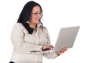Business lady typing and looking at laptop