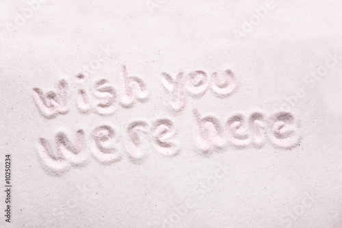 Poster Wish you were here written in luxerious white sand