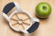 Apple and Slicer on a Wood Background