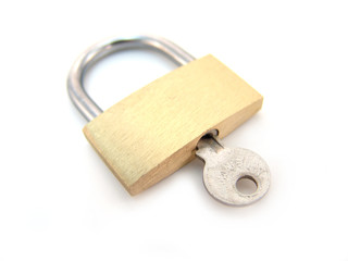 brass padlock with key - locked