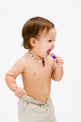 Cute topless toddler boy with open mouth singing, isolated