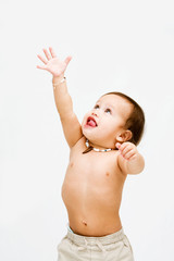 Cute topless toddler boy reaching for the sky, isolated