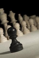 Black pawn against white pieces.