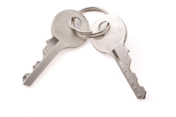 Two small old keys with clipping path on white background