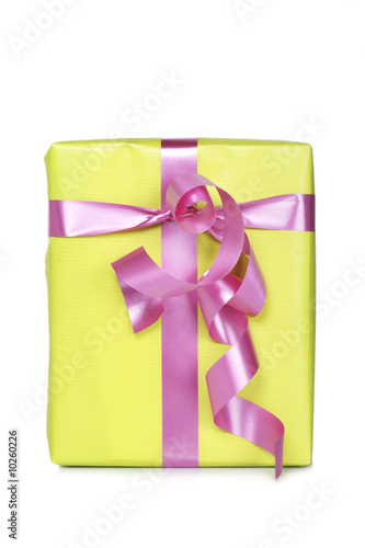 Gift box, reflected on white background. Shallow depth of field