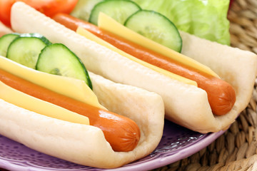 two fresh and delicious hot dogs with vegetables