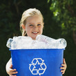 Little Girl Holding Recycling Bin.