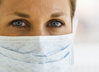 Close up of Female Doctor with Mask on.