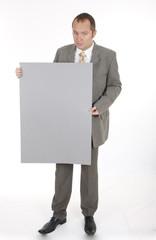 businessman holding a billboard