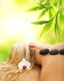 Fototapety Massage with volcanic hot stones