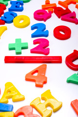 Brightly colored plastic letters  - Mathematics