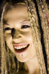 Laughing Woman with Face Piercings and Dread Lock Hair