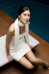 Young Asian Woman Sitting Down