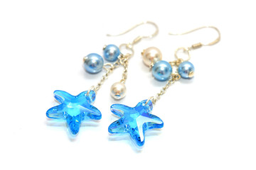 A pair of star shape bead earrings on white background.