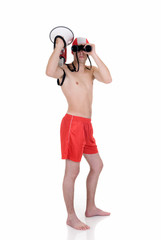 Young handsome lifeguard with megaphone and binoculars