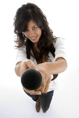 female singer offering microphone to sing on white background