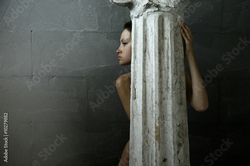 Beautiful woman with antique greek column