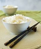 two bowls of plain rice and chopsticks