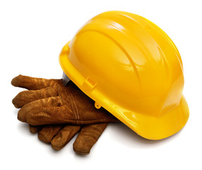 Yellow hardhat and old leather gloves isolated
