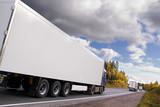 caravan of trucks, highway, truck slightly blurred in motion poster