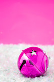 pink christmas bell  surrounded by fake snow poster