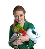 young woman in green with household appliances and present