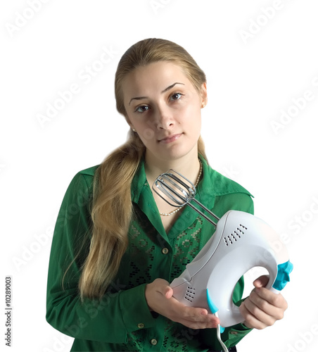 young woman  in green blouse with electric food mixer