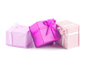 pink scattered, colorful small gift boxes for giving