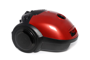 New small red vacuum cleaner isolated on the white