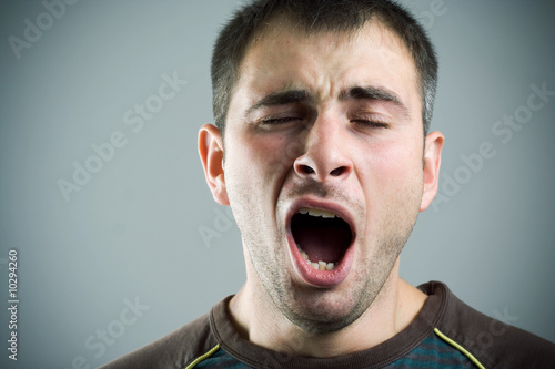 Yawning young man.
