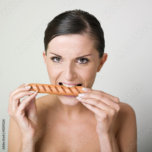 woman eating sausage.