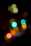 An abstract bokeh background with blurred light blobs. poster