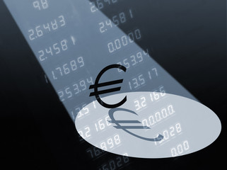 Spotlight falling on Euro currency symbol with numbers