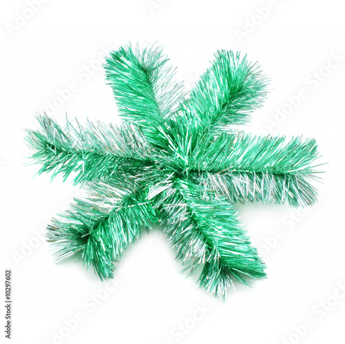 Green sparkle snowflake isolated on a white background