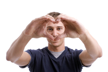 Young Man Drawing Heart with Hands - focus on eyes