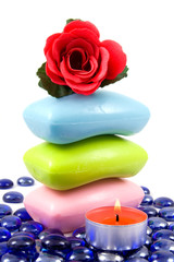Colourful soap bars and aroma rose  on a white background