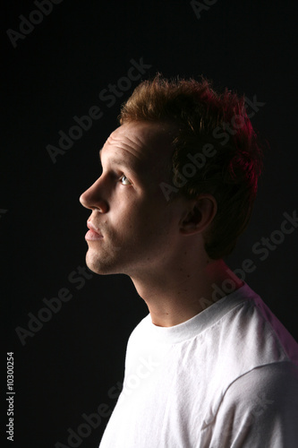 profile of attractive man with receding hair and facial stubble