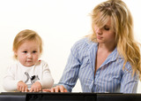 Mom teaching baby girl to play keyboard poster