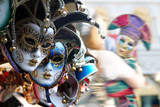 Row of venetian masks in gold and blue