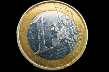 An isolated to balck close up of the front of a 1 Euro coin