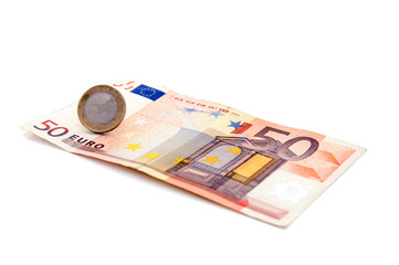 An isolated to white image of a 50 euro note and a 1 euro coin