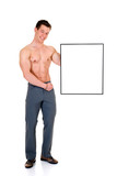 Young attractive male body builder with advertising board.