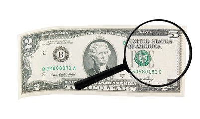 Magnifying lens changes dollar bill