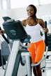 beautiful woman at the gym exercising in the cardio