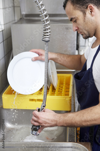 man washing dishes.